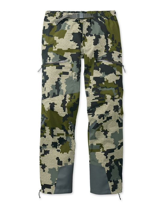 If you're preparing for a tough hunt that's wet and brush-choked, you need protection from a rain gear system that's durable, lightweight, and dries quickly. The Kutana Storm Shell Pant features an entirely new microporous hydrophobic membrane from Toray that breathes even when activity level is minimal, and absorbs very little water for incredibly fast dry times. The durable stretch nylon 6/6 face fabric offers great tear strength for its weight, and will stay dry longer due to a new, more durable K-DWR treatment. The new Torain 3-layer construction from Toray adds a revolutionary new seam tape that, along with the membrane, give enhanced hydrolysis resistance for significantly improved garment longevity. Designed with the features you need for all-day use, including cargo pockets, full-length leg zips, a built-in waist belt, and Bemis overlay film on the cuff for abrasion protection, the Kutana Storm Shell Pant furthers our never-ending goal of offering improved performance and durability at a lighter weight.