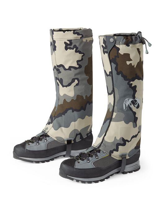 At just 4 oz each, this ultralight design won't hinder your decision to use a gaiter in unpredictable weather while hunting sheep, elk or deer. Perfect for keeping heavy rain, light snow and debris from entering the top of your boots. The Kutana Gaiter streamlines the lower pant leg, minimizing cuff-to-cuff contact when being quiet is a must.  The Kutana Gaiter features an entirely new microporous hydrophobic Toray ENTRANT membrane that breathes even when activity level is minimal and absorbs very little water for incredibly fast dry-times. The durable stretch nylon 6/6 face fabric offers incredible tear strength for its weight class and stays dry longer, thanks to the highly durable K-DWR treatment. Features a reinforced 330D Cordura internal lining for added structure, durability and boot protection.  The hook and loop anchored boot strap easily adjusts to your boots without the use of buckles. The TPU coated boot strap is highly durable, even across sharp rocks—the strap is also replaceable if you ever happen to wear one out.  The top closure draw cord features an easy-to-use cinch system with split ends to avoid snags on brush. A silicone print traction strip also keeps the gaiter held in place.  The Kutana Gaiter is positioned between the KUIU Scree and Yukon gaiters, making it the ideal choice when wet weather is unavoidable, and temperatures are moderate.