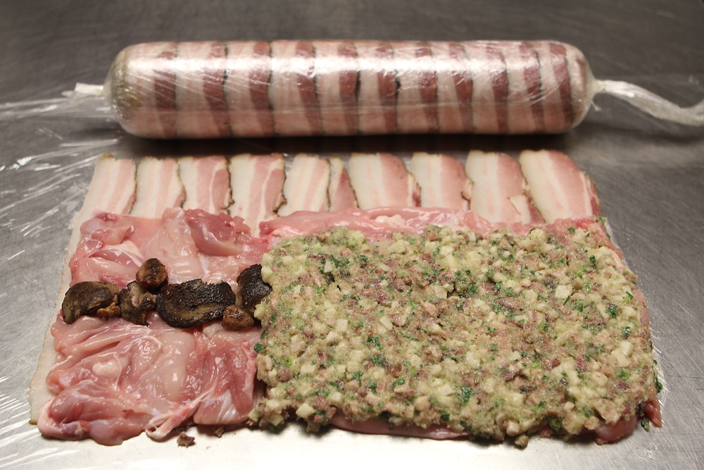 Boned out rabbit on a bacon base is stuffed with rabbit offal and pig head.