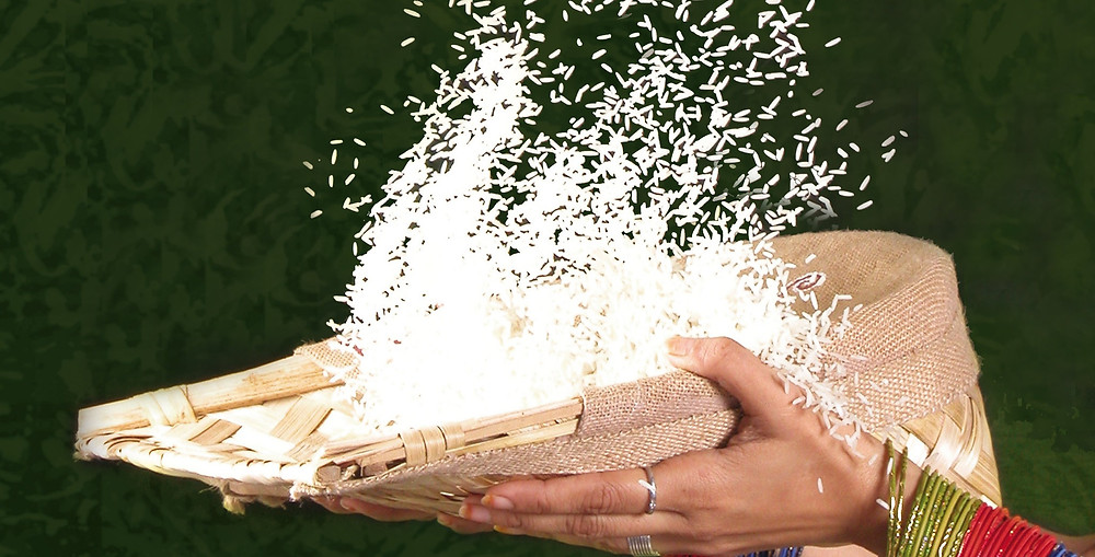 Woman tossing a bowl of rice in the air