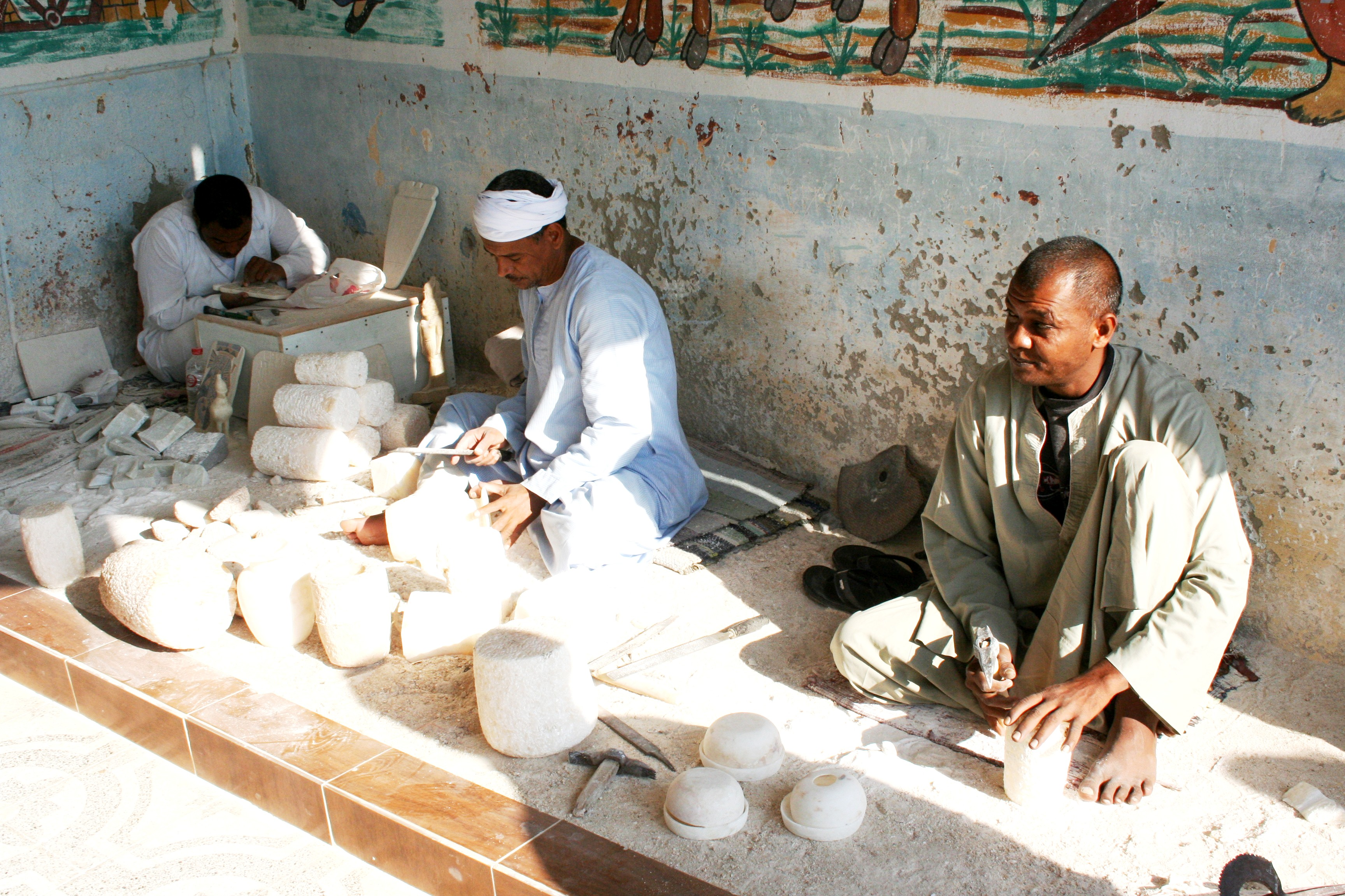 Men Carving Stone