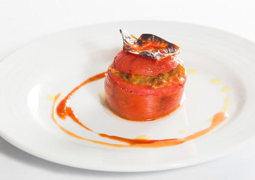 Pomodoro con parmigiana di melanzane al forno