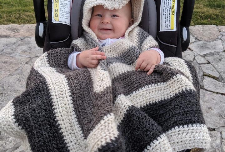 Handmade car seat poncho with alpaca yarn