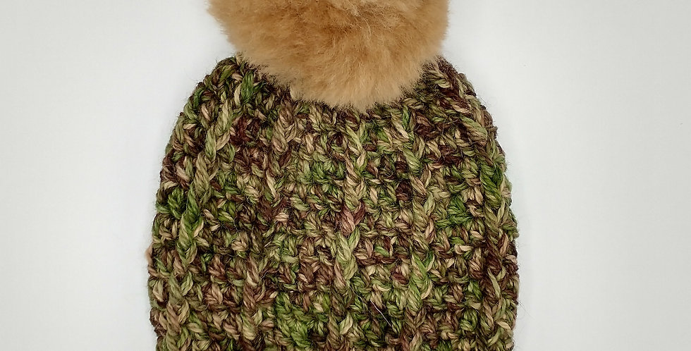 Handmade children's crocheted camo hat with tan fuzzy pom