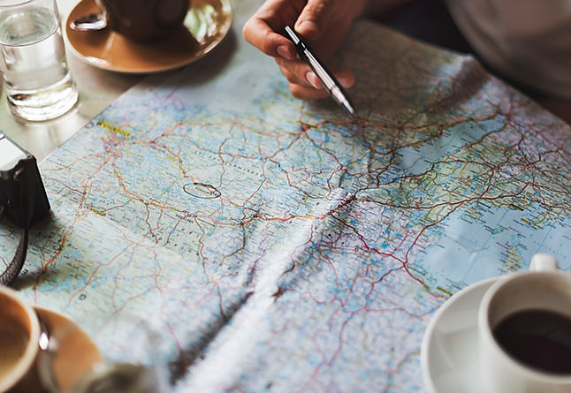 Spread out map with circled sharpie destination for navigation planning
