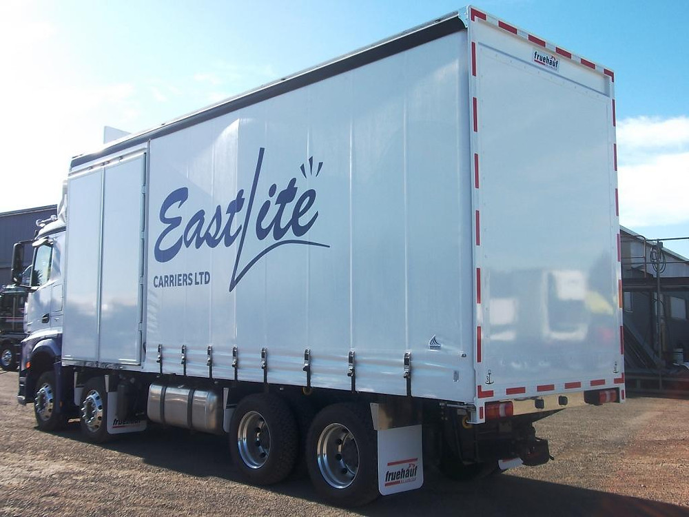 Eastlite MB Arocs with Fruehauf body by easytrucks