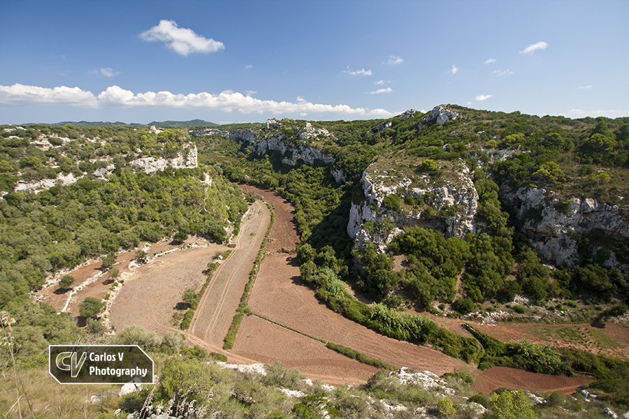 The view from the ruins of the village at Sant Agustí Vell. This ravine holds several natural and artificial caves used during the Talaiotic period.  © Carlos Vermeersch