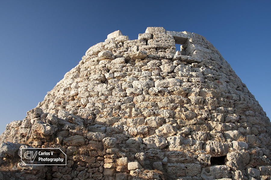 Torelló 1 is the largest and best preserved talaiot of the Balearic Islands, still possessing one of its gates at the top.  © Carlos Vermeersch
