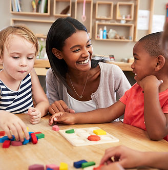 Teacher And Pupils Using Wooden Shapes In Montessori School.jpg