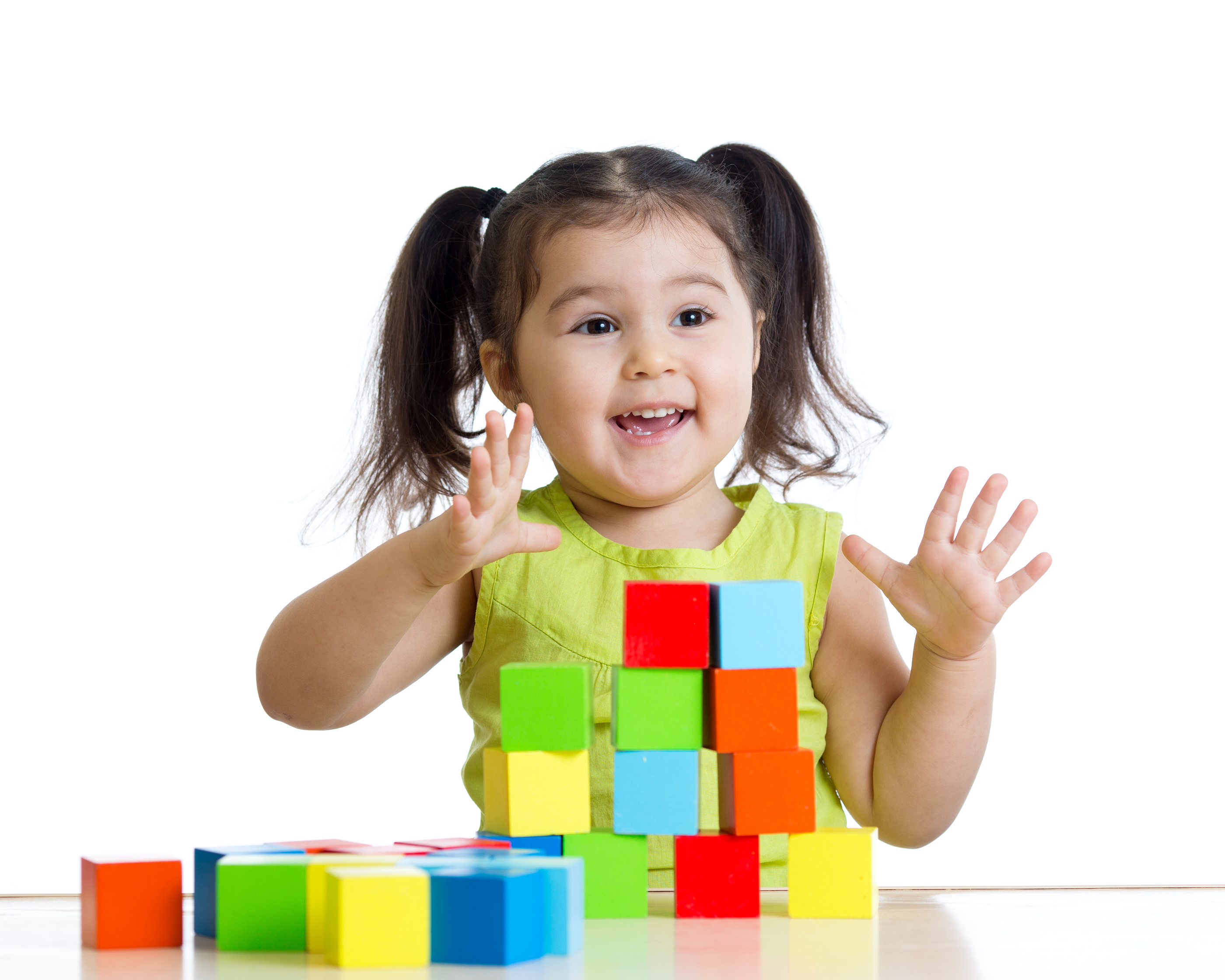 toddler child playing wooden toy blocks isolated
