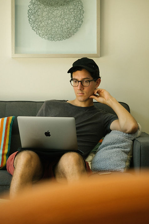 Canva - Man Using Macbook While Sitting