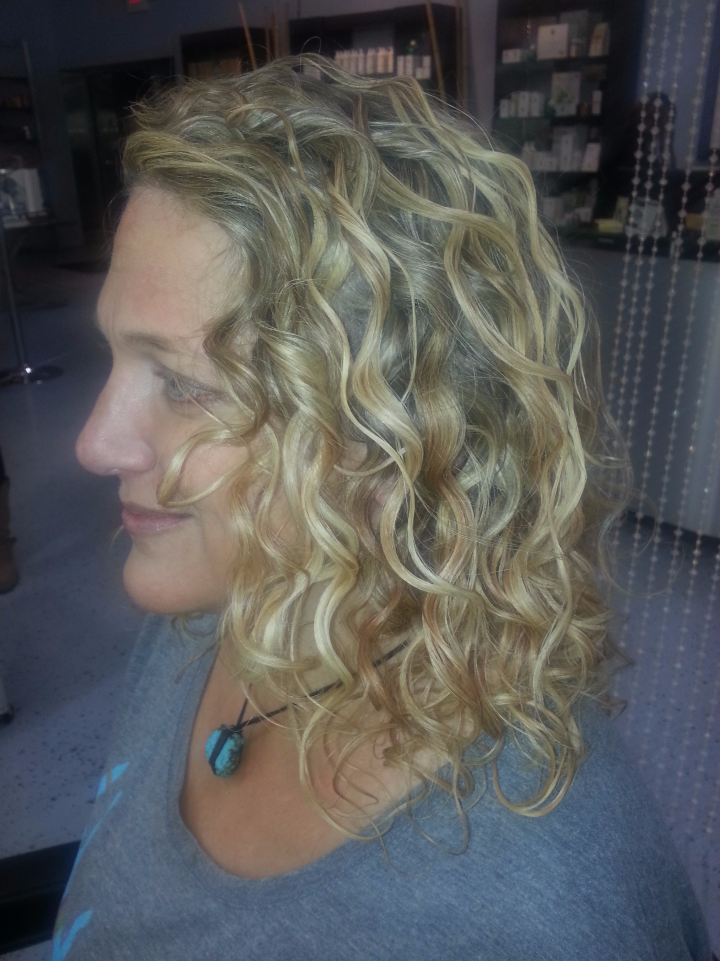 Curly blonde balayage