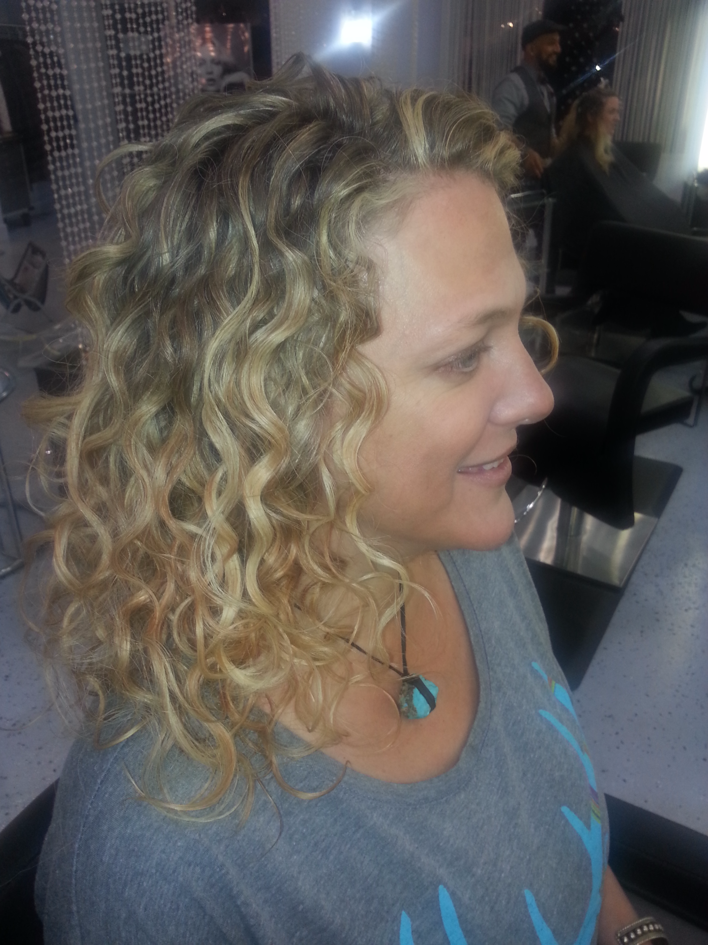 Curly blonde balayage side