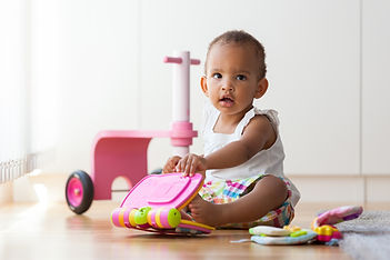 baby and pink toy.jpg