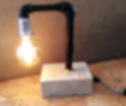 מנורה מבטון עם צנרת