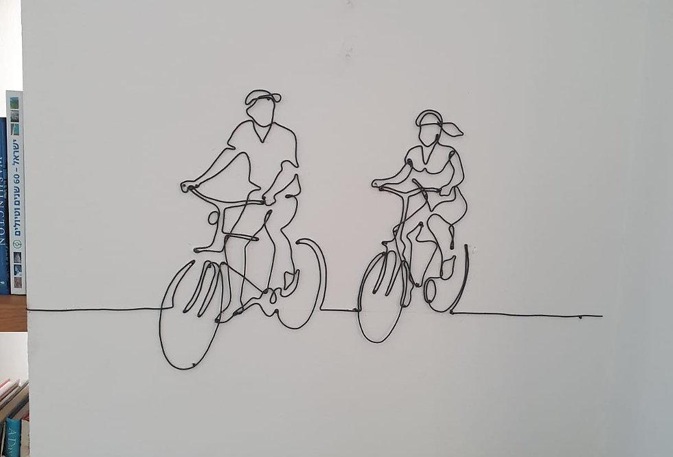 תמונת ברזל - זוג על אופניים
