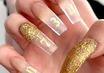 gel x gold nail art design