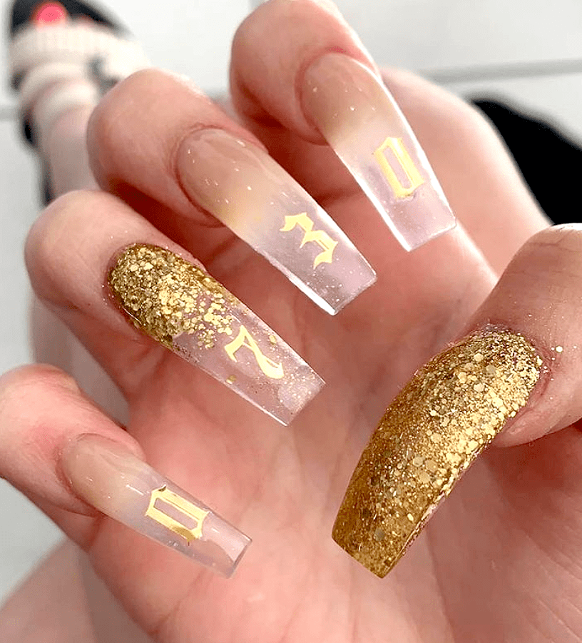 gel x gold nail art design