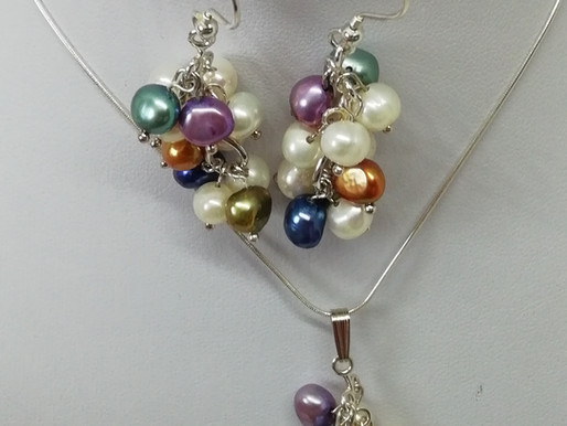Handmade Multi-coloured freshwater pearls set on a sterling silver chain pendant