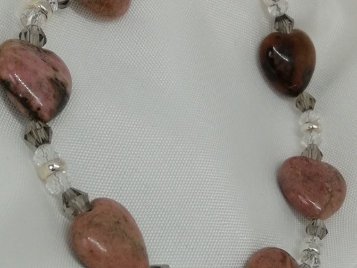 Handmade Pink jasper puffy hearts with crystals and silver donuts finished bracelets