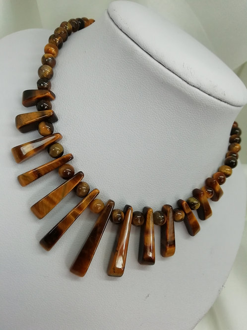 Tiger's eye bons in two styles, both with sterling silver necklace