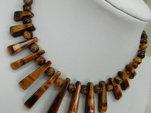 Handmade Tiger's eye bons in two styles, both with sterling silver necklace