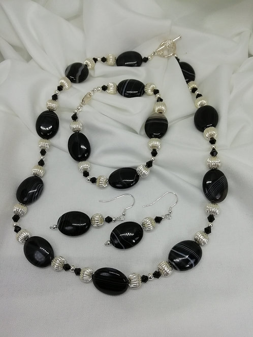 Handmade Banded black agate ovals set with black crystal/silver necklace