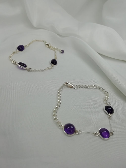 Handmade Pretty amethyst cabochons set in silver in a Oval with trace chain bracelets