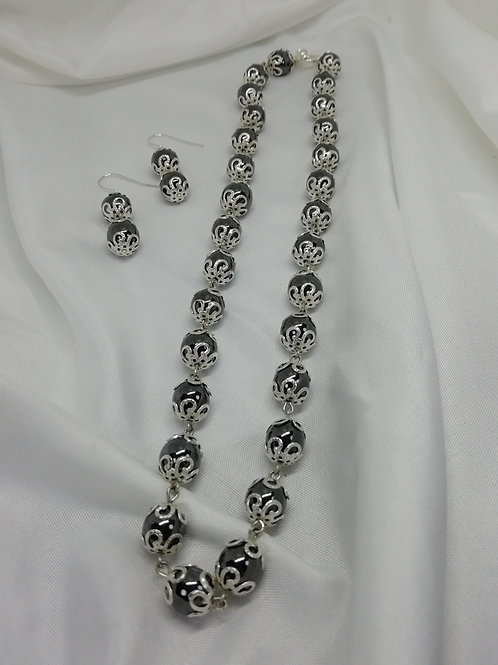 handmade Hematite beads with silver end caps in a full necklace