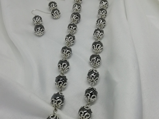 Handmade Hematite beads with silver endcaps in a full necklace
