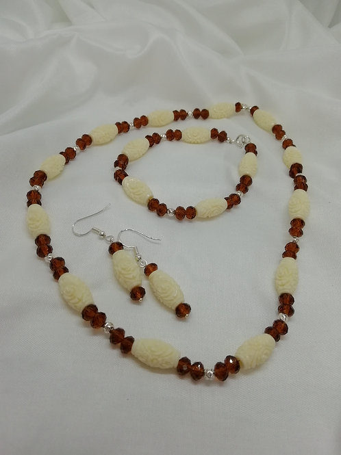 Handmade Coral barrels carved with a rose design set off amber coloured crystals necklace