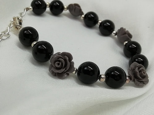Handmade Black onyx beads with dyed coral carved roses and silver spacers bracelets