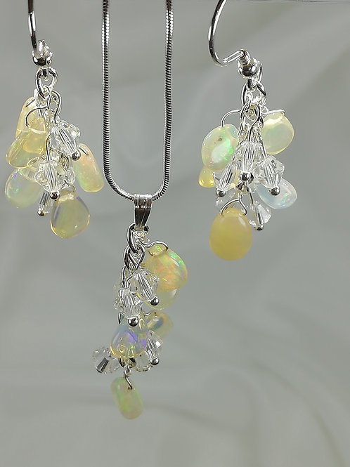 Handmade Pear-shaped opals with crystals set on a sterling silver pendant