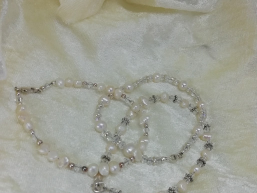 Handmade Freshwater pearls set with crystals and silver spacers bracelets