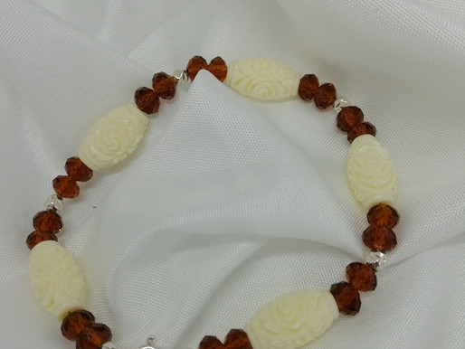 Handmade Coral barrels carved with a rose design set bracelets