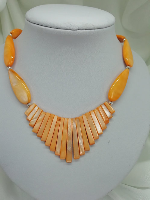 Handmade Orange shell pearl batons carried on an orange shell pearl necklace