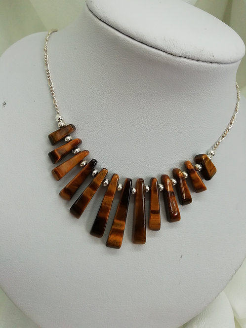 Tiger's eye batons in two styles, both with sterling silver necklace
