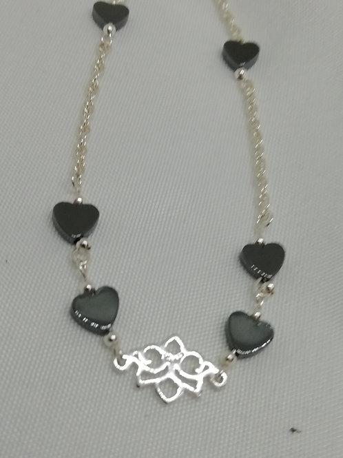 Handmade Delicate hematite hearts enhance a silver filigree bracelets