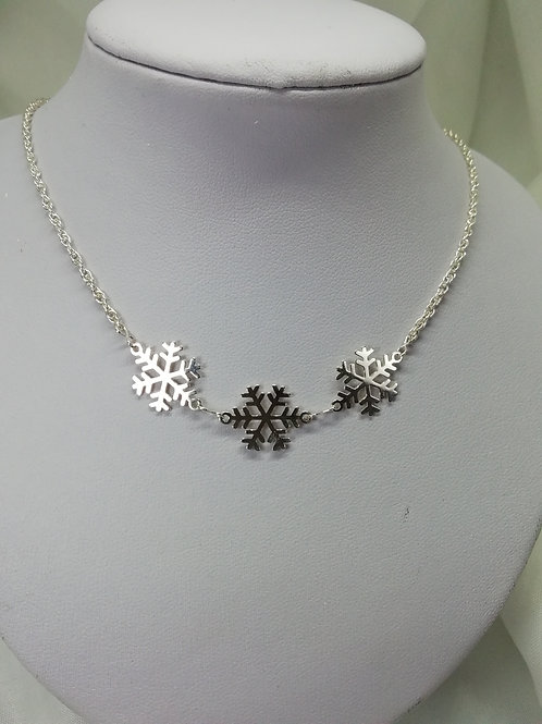 Handmade Sterling silver snowflakes on a sterling silver necklace