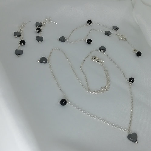 Handmade Dainty hematite hearts and black onyx beads set off this sterling necklace