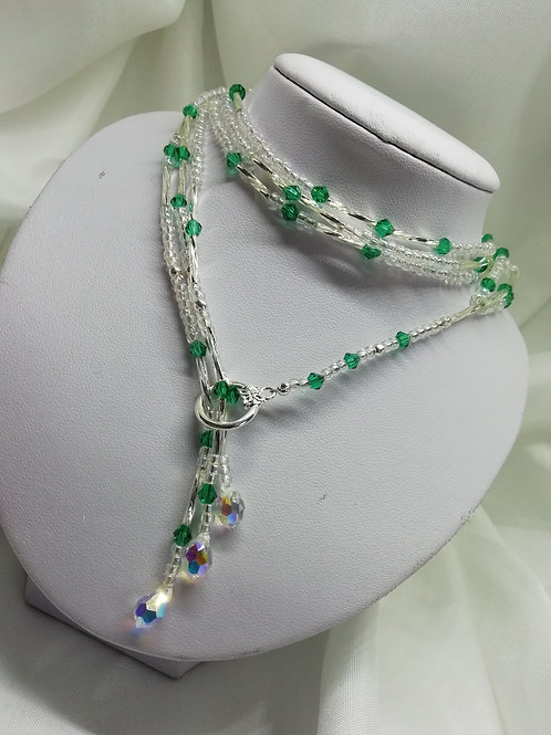 Handmade A pretty lariat style necklace comprised of green crystals with silver necklace