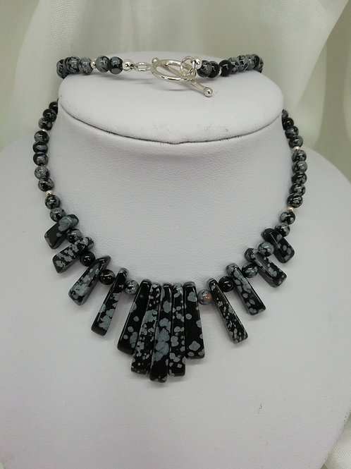 Snowflake obsidian batons featuring unusual necklace