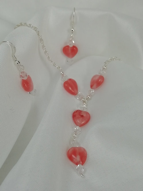 Cherry agate puffy hearts with crystals in a dainty drop design necklace