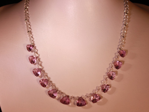 Handmade Faceted trillian cut amethysts set on a swarovski crystal necklace