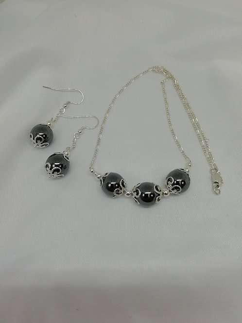 Large hematite beads with silver necklace