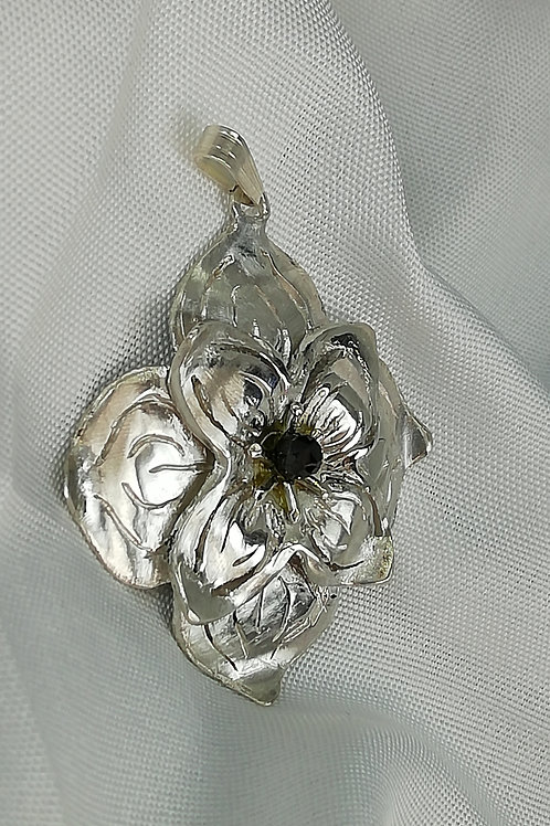 Handmade Hallmarked sterling silver lily flower with a faceted black pendant