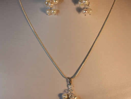 Handmade Freshwater pearls set on a sterling silver chain pendant
