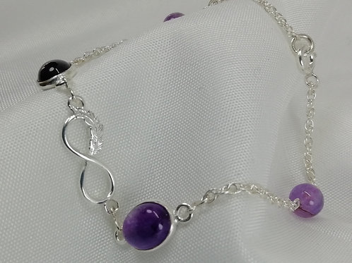 Oval Amethyst Cabochon Set with Silver Infinity Connector featuring Bracelet