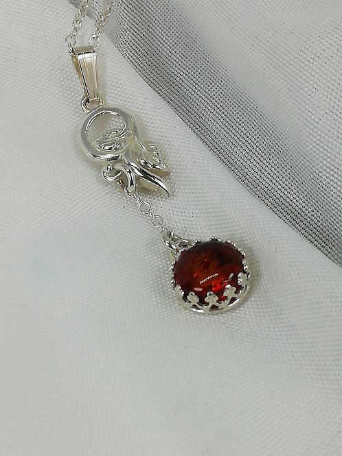 Handmade Sterling silver vine leaf set with an amber cabochon in galleried silver pendant