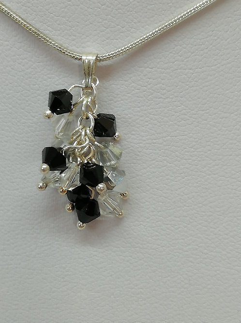 Handmade Black and clear crystals set on a sterling silver chain pendant